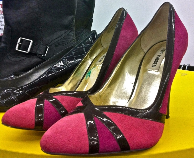 Sexy, playful, and yet super practical, these bright pink suede pumps with black, criss-cross detail are a stylish way to add a burst of fresh spring color to any ensemble.