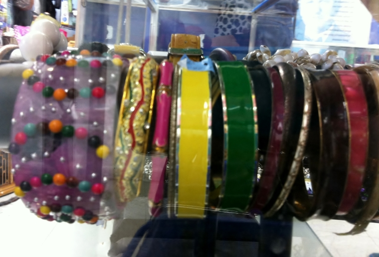 For a more easy-going, but still elegant, way to use your favorite accessories, try piling on a colorful stack of bracelets all at once, like this luscious lineup I spotted at my local Goodwill shop.