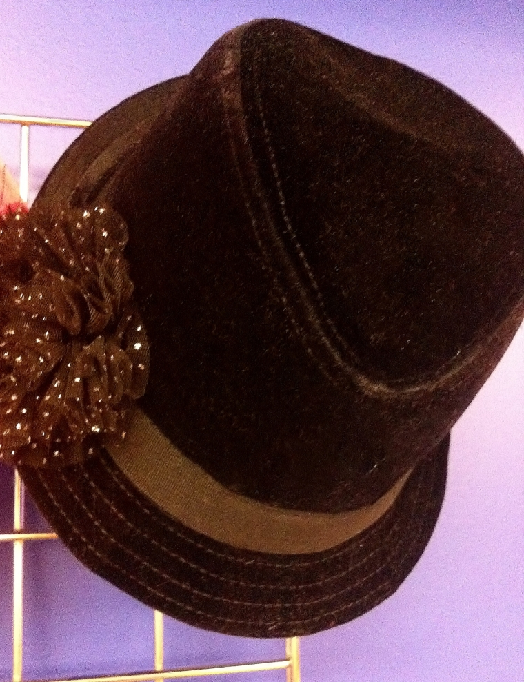 Borrowed from the boys, this brown velvet hat has a few details that are distinctively feminine and give it a flirtatious edge.