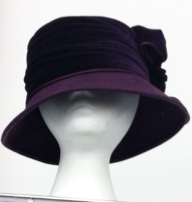Though it might seem a little old-fashioned at first glance, this alluring head-topper in a luscious aubergine purple is the perfect vintage pick to keep you warm and stylish throughout the fall and winter.
