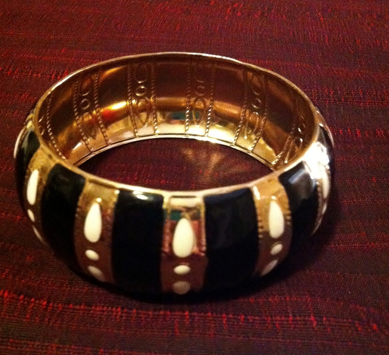 Large gold bangle with white and black detail