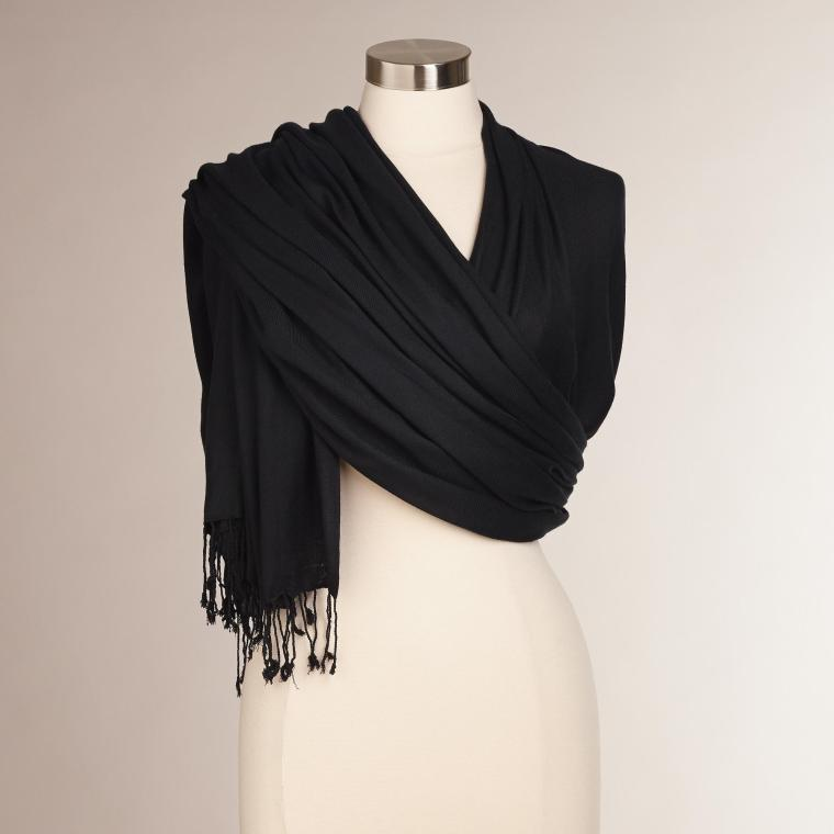 black pashmina drapped on mannequin