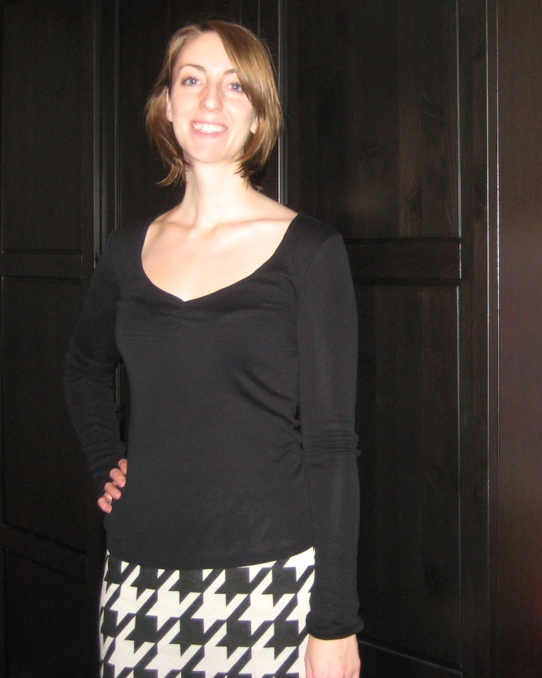 black v-neck top with black and white geometric skirt