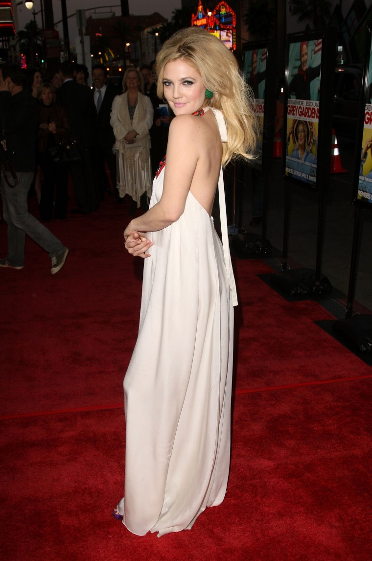 "Drew Barrymore arriving at the premiere of HBO Films' ""Grey Gardens"" wearing a white halter maxi dress"