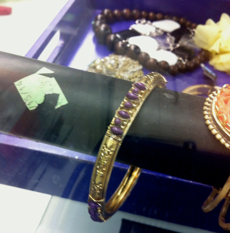 gold bracelet with purple gems