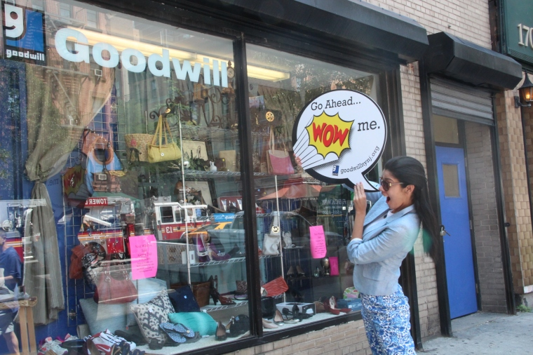 Our model, Barbra, outside the Stuyvesant Store with her Goodwill sign