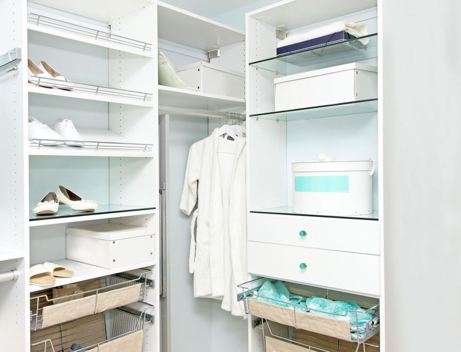 37537417 - detail of large walk in closet with wardrobe on hangers